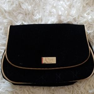 Black and gold dior makeup bag
